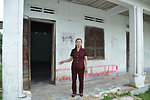 A local official shows the previous rooms where kindergarten classess were held in one commune in Kon Tum Province.