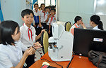 Checking new student eyeglasses in Kon Tum