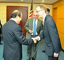 Deputy Minister Bui Cach Tuyen, Ministry of Natural Resources and Environment greets USAID Mission Director Joakim Parker at the Seventh U.S.-Vietnam Advisory Committee Meeting (JAC)