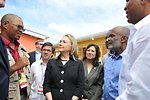 Secretary Clinton Is Briefed By USAID/Haiti Engineer Nicoleau