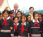 Ambassador Michael Michalak and Truong Thi Ngoc Anh meet with students at the Kon Ray School