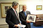 Secretary Kerry Presents Secretary Hagel a Photo of the Two