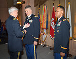 Major Gen. Walsh pins the Legion of Merit medal on Col. Leady