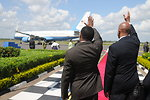 Ambassador Lenhardt and Tanzanian Foreign Affairs Minister Membe Wave Goodbye To Secretary Clinton