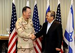 Admiral Mullen Shakes Hands With Israeli Defense Minister Barak