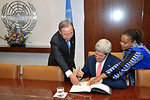 Secretary Kerry Signs a Guestbook at the United Nations