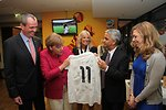 Chancellor Merkel is Presented with an Autographed U.S. Women's Jersey