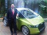 Acting Deputy Assistant Secretary Keshap Stands Beside a Mahindra Reva Electric Car