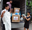 Vietnamese officials inspect personal protective equipment in Hanoi