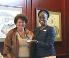 World Affairs Council of Las Vegas President Whiteside Presents a Gift to Assistant Secretary Brimmer