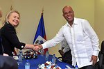 Secretary Clinton Shakes Hands With Haitian President Martelly
