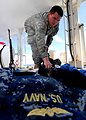 Army Specialist James Wood Sprays Service Working Uniforms and Clothing With Permethrin
