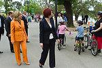 Australian Prime Minister Gillard and Secretary Clinton Greet People Along the Yarra River