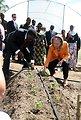 Secretary Clinton and Tanzanian Prime Minister Pinda Plant Seedlings