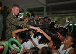 U.S., Philippine servicemembers visit school children
