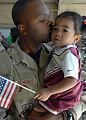 Hugs, kisses, handshakes for returnees