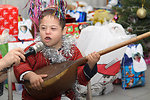 A Turkmen Boy Plays an Instrument