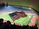 An American Waves 'Old Glory' at U.S. vs. England Match