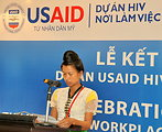 A beneficiary of USAID HIV Workplace Project, who belongs to Thai ethnic minority group and lives in Dien Bien province, tells her story at the event.
