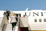 Secretary Clinton Boards the Plane To Depart Melbourne