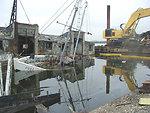 Spring 2002, wooden sail boat awaits removal