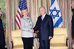 Secretary Clinton Shakes Hands With Israeli President Peres
