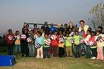 Dr. Jill Biden and Liz Berry Gips With Mapetla Staff and Children