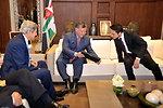 King Abdullah II and Crown Prince Hussein Admire a Photo
