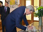 Secretary Kerry Signs the Guestbook at NATO Secretary General Rasmussen's Residence