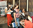 A beneficiary of USAID HIV Workplace Project talk to reporters on the sidelines of the event.