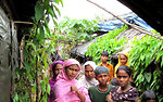 Rohingya Refugee Women Stand By Their Homes