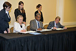 Secretary Clinton, Haitian Prime Minister Bellerive, and French Foreign Minister Kouchner Sign an MOU