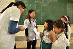 School children receive a dose of deworming medicine in Dien Bien Phu