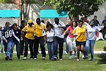 Zambian and American Pairs Partner in 3-Legged Race