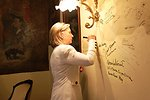 Secretary Clinton Signs the Wall of the Solski Room at the Slowacki Theater