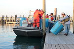 December 3, 2012 – Crews return to dock with collected drums and containers