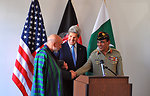 Secretary Kerry Looks on as Afghan President Karzai and Pakistani Chief of Army Staff General Kayani Shake Hands