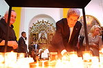 Secretary Kerry Lights a Prayer Candle