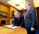 Secretary Clinton Signs the Guestbook at Taoiseach Kenny's Office