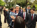 Secretary Kerry Laughs After Getting a Hug from a Japanese Child at Zojoji Shrine