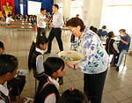 U.S. Deputy Chief of Mission Claire Pierangelo distributes toothbrushes and toothpaste at a dental screening at Kon Ray school