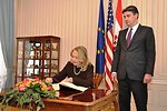 Secretary Clinton Signs the Guestbook