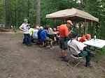 Scouts work on Pulp and Paper merit badge at the USFS exhibit