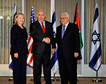 Israeli Prime Minister Netanyahu and Palestinian President Abbas Shake Hands as Secretary Clinton Looks On
