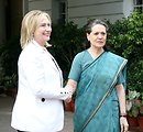 Secretary Clinton Is Greeted By All India's Congress Party President Gandhi