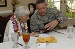 PACAF commander presents medallion to World War II nurse