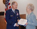 Widow receives husband's World War II medal