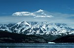 Photo #12 of Mount St. Elias sequence. Mount Saint Elias is one of the largest mountains visible from the sea on the North American continent.  It rises to a height of 18,008 feet in a distance of less than 20 miles from sea level at Icy Bay.