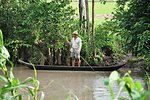 A farmer plies the waters of the Mekong Delta in southern Vietnam