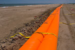 June 1, Flood control devices staged to block oil from washing inland